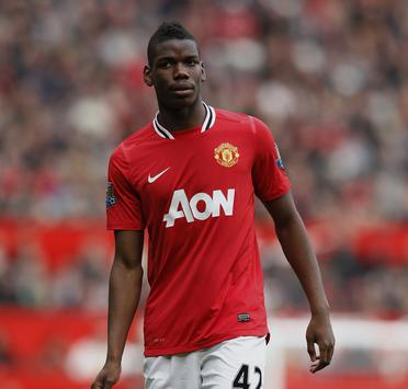 """Manchester United's Paul Pogba walks across the pitch during their English Premier League soccer match against West Bromwich Albion at Old Trafford in Manchester, March 11, 2012. REUTERS/Phil Noble (BRITAIN - Tags: SPORT SOCCER) FOR EDITORIAL USE ONLY. NOT FOR SALE FOR MARKETING OR ADVERTISING CAMPAIGNS. NO USE WITH UNAUTHORIZED AUDIO, VIDEO, DATA, FIXTURE LISTS, CLUB/LEAGUE LOGOS OR """"LIVE"""" SERVICES. ONLINE IN-MATCH USE LIMITED TO 45 IMAGES, NO VIDEO EMULATION. NO USE IN BETTING, GAMES OR SINGLE CLUB/LEAGUE/PLAYER PUBLICATIONS - RTR2Z7JS"""